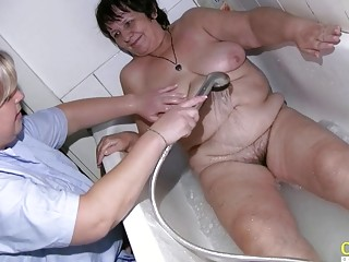 OldNannY grasping grandmother While Taking a tub