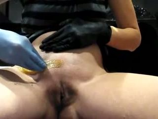 Mature blonde woman showing how to wax your own pussy