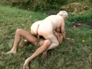 Pale skin mature BBW lady outdoors having sex with a freak in the mask