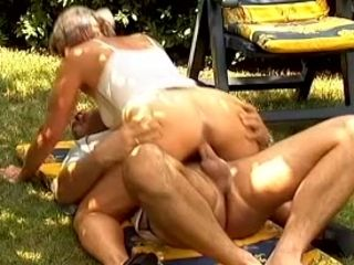 Horny and wild white mature lady in the garden ridin on a dick