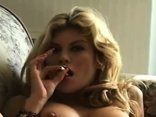 Mature doxy blows a guy while smokin' a cigarette