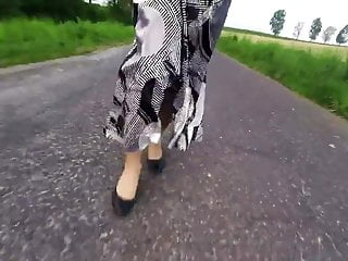 Point of view ambling in a lengthy satin mini-skirt