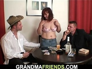 Red-haired elderly mature double-fucked after card game