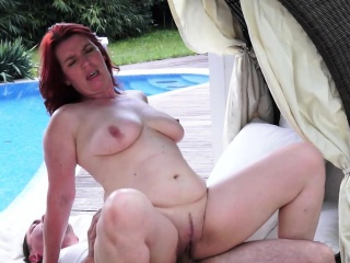 Busty redhead gilf fucked in outdoor action