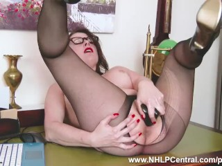 Pantyhosed mischievous office cougar Karina Currie tears up humid cunny with plaything on desk