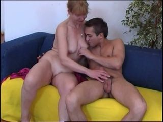 Busty blonde cougar blows dick of a college guy and rides him on top