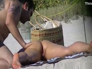 Man puts cream on hot wife's body